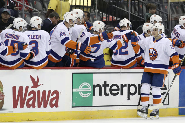 New York Islanders center Mathew Barzal (13) celebrates after scoring a goal against the New Jersey Devils during the second period of a preseason NHL hockey game, Saturday, Sept. 21, 2019, in Newark, N.J. (AP Photo/Mary Altaffer)