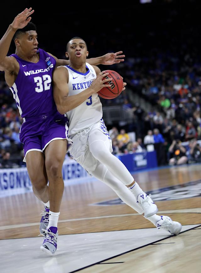 Kentucky's Keldon Johnson, right, drives against Abilene Christian's Joe Pleasant (32) during the first half of a first-round game in the NCAA mens college basketball tournament in Jacksonville, Fla. Thursday, March 21, 2019. (AP Photo/John Raoux)
