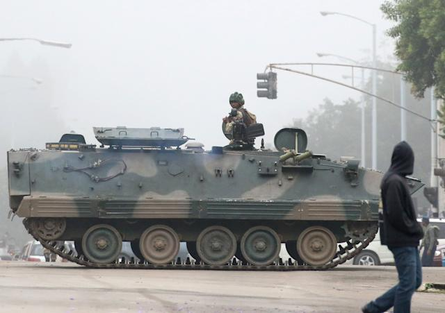 Military vehicles and soldiers patrol the streets in Harare on Nov. 15.