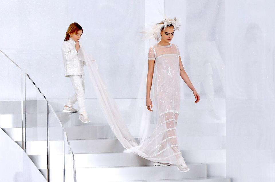 "<p>After his debut at the Chanel Spring 2011 show in Paris, Hudson Kroenig, Karl Lagerfeld's godson, was <a href=""https://www.wmagazine.com/gallery/hudson-kroenig-chanel-model/"" rel=""nofollow noopener"" target=""_blank"" data-ylk=""slk:incorporated into every Chanel show"" class=""link rapid-noclick-resp"">incorporated into every Chanel show</a>. Since the late fashion designer had no children, he treated Hudson like his own. </p>"