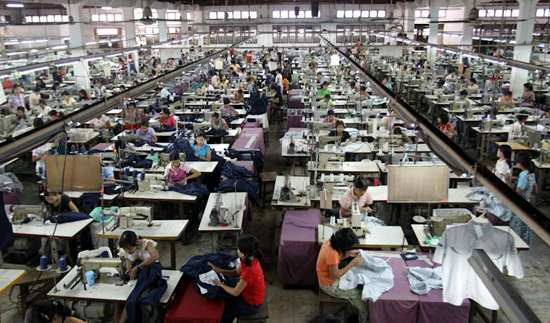 In this photo taken Saturday, April 21, 2012, young laborers work at a garment factory in Yangon, Myanmar. On Monday, April 23, 2012, the European Union confirmed it was suspending most of its sanctions against Myanmar to reward the country's recent wave of political reform. The suspension of trade sanction could help revive the nation's industries, restoring some of the 80,000 garment industry jobs lost here over the past 10 years. (AP Photo/Sakchai Lalit)