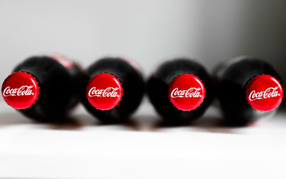 Coca-Cola bottles are seen in this illustration photo taken in Krakow, Poland on October 8, 2020. (Photo Illustration by Jakub Porzycki/NurPhoto via Getty Images)