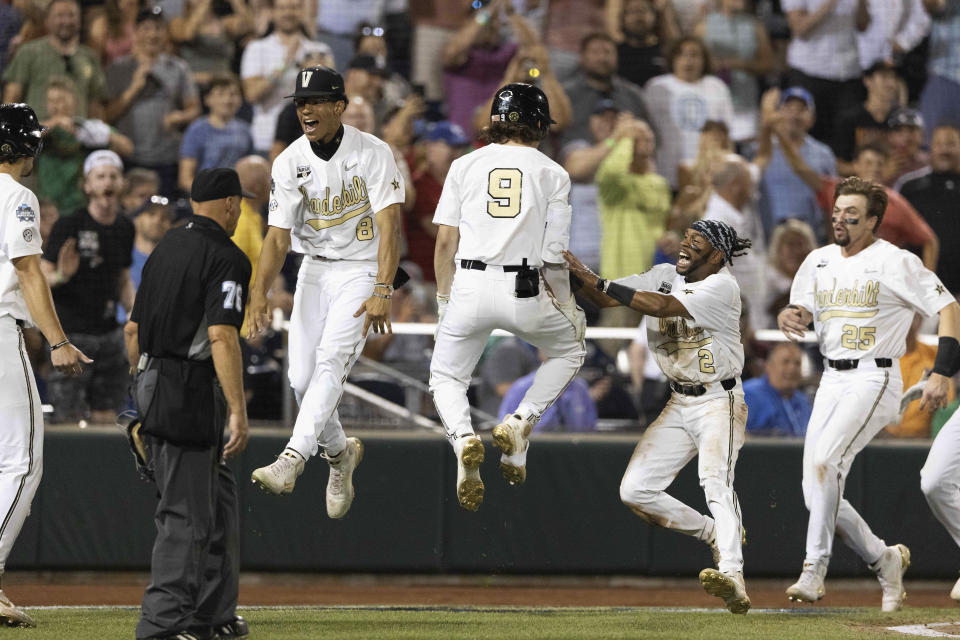 Vanderbilt's Isaiah Thomas (8), from left, Carter Young (9), Javier Vaz (2) and Parker Noland (25) celebrate their 6-5 win against Stanford during a baseball game in the College World Series Wednesday, June 23, 2021, at TD Ameritrade Park in Omaha, Neb. (AP Photo/Rebecca S. Gratz)