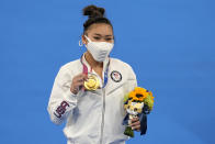 Sunisa Lee of the Unites States displays her gold medal for the artistic gymnastics women's all-around at the 2020 Summer Olympics, Thursday, July 29, 2021, in Tokyo. (AP Photo/Natacha Pisarenko)