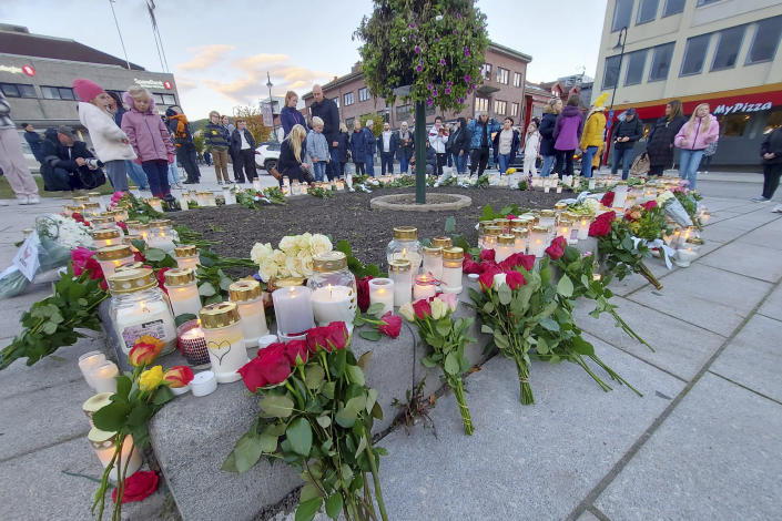 Flowers and candles are placed at a memorial after a man killed several people on Wednesday afternoon, in Kongsberg, Norway, Thursday, Oct. 14, 2021. The bow-and-arrow rampage by a man who killed five people in a small town near Norway's capital appeared to be a terrorist act, authorities said Thursday, a bizarre and shocking attack in a Scandinavian country where violent crime is rare. Police identified the attacker as Espen Andersen Braathen, a 37-year-old Danish citizen, who was arrested on the street Wednesday night. (AP Photo/Pal Nordseth)