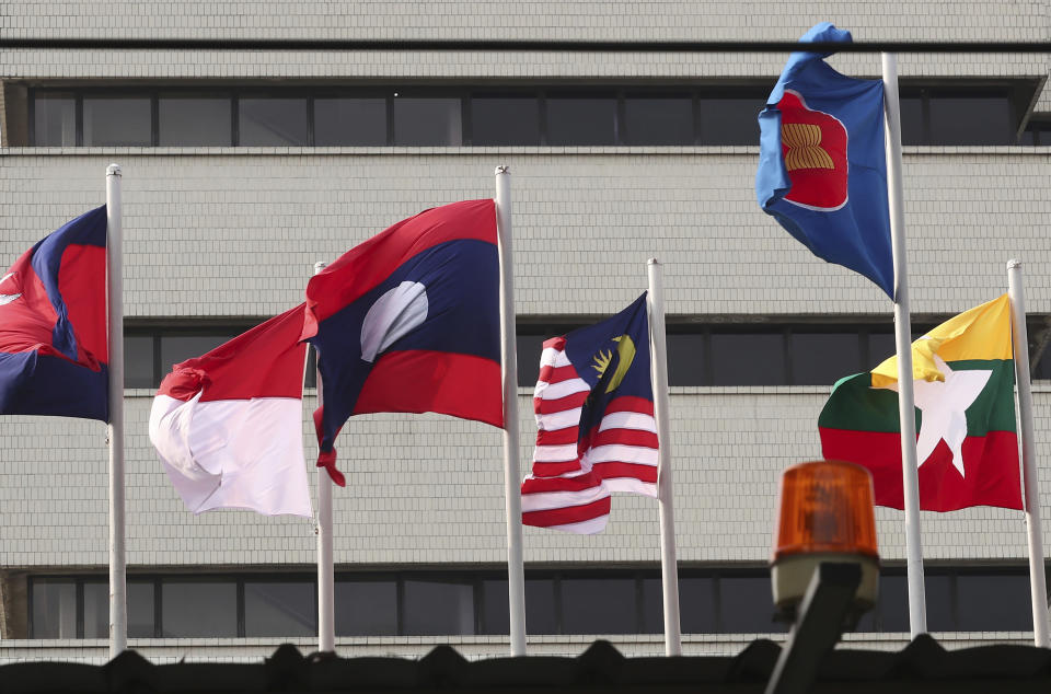 In this April 22, 2021, file photo, flags of some of the ASEAN member countries fly at the ASEAN Secretariat in Jakarta, Indonesia. Southeast Asia's top diplomats were meeting Monday, Aug. 2, 2021, to appoint a special envoy to help deal with the political crisis and violence gripping Myanmar and finalize an emergency plan to help control a coronavirus outbreak that many fear is spiraling out of control in the military-ruled nation. (AP Photo/Tatan Syuflana, File)