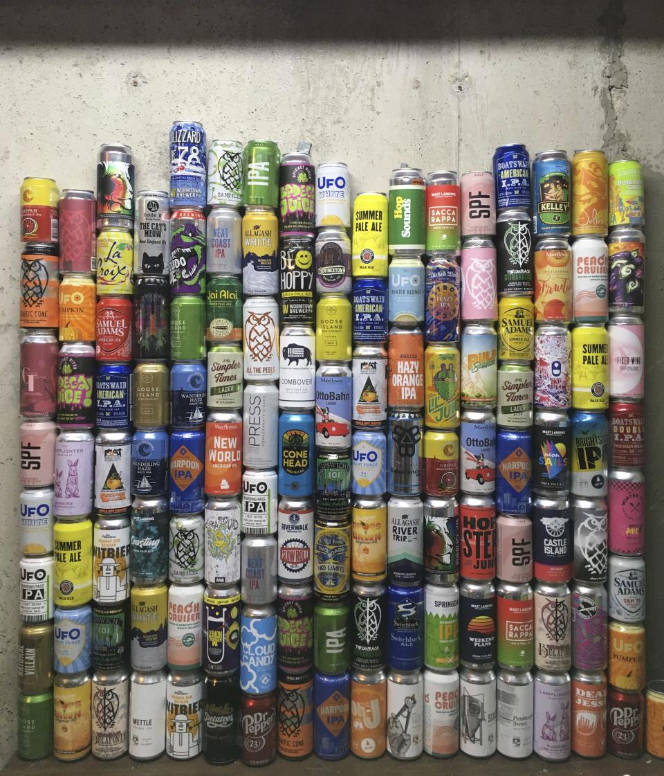 This Jan. 1, 2021 photo shows a collection of empty beer cans, consumed during the pandemic, at a home in North Andover, Mass. This year's Dry January came as many people had seen an uptick in their alcohol intake. Addiction treatment experts note that a month of forced sobriety might not have a lasting impact and could lead to binge drinking in February. But others believe the annual show of sobriety can't hurt. (Mary Schwalm via AP)