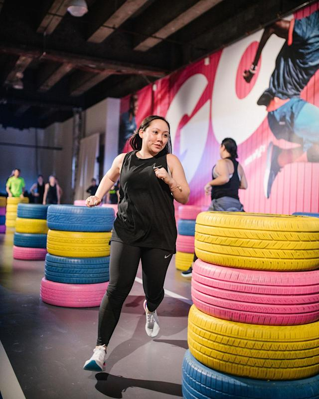 Yahoo's Lifestyle fashion editor, Julie Tong, tests out the Epic React Flyknits at the Nike press preview event. (Photo: Courtesy of Nike)