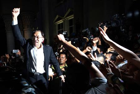 Malaysian opposition leader Anwar Ibrahim shouts to his supporters at a court house in Putrajaya