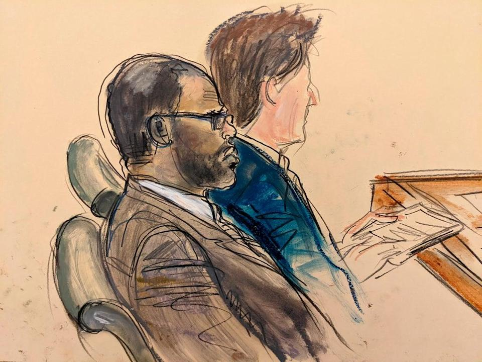 In this courtroom artist's sketch made from a video screen monitor of a Brooklyn courtroom, defendant R Kelly, left, listens during the opening day of his trial on 18 August 2021 in New York (AP Photo/Elizabeth Williams)