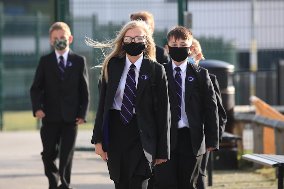 Pupils wear protective face masks on the first day back to school at Outwood Academy Adwick in Doncaster, as schools in England reopen to pupils following the coronavirus lockdown.