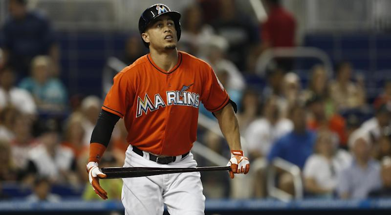 Miami Marlins batter Giancarlo Stanton watches as his ball goes foul during the second inning of a baseball game in Miami against the San Diego Padres, Sunday, June 30, 2013. (AP Photo/J Pat Carter)