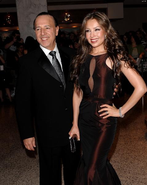 """FILE - This May 9, 2009 file photo shows music mogul Tommy Mottola, left, and his wife, singer Thalia, at the 2009 White House Correspondents' Dinner in Washington. A decade after leaving Sony Music Entertainment, Tommy Mottola tells his story in a new book, """"Hitmaker: The Man and His Music."""" (AP Photo/Evan Agostini, file)"""