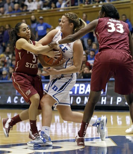 Duke's Tricia Liston, center, struggles for possession of the ball with Florida State's Yashira Delgado (5) and Natasha Howard (33) during the first half of an NCAA women's college basketball game in Durham, N.C., Friday, Feb. 22, 2013. (AP Photo/Gerry Broome)