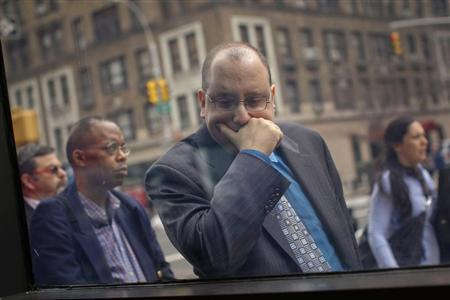 A man waits in line to enter the UJA-Federation Connect to Care job fair in New York