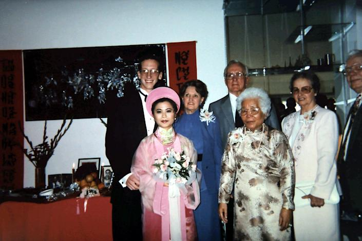 """The real Madame Ty Vu, in traditional Vietnamese """"ao dai,"""" next to the real Grandma Mary Simons, right, at the wedding of grandchildren Thuan and Bob Elston in 1995 in Southern California."""