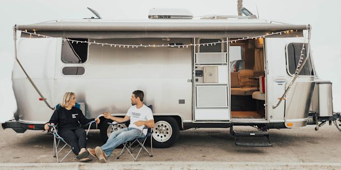 Heather DeSantis and her fiance in front of their Airstream.