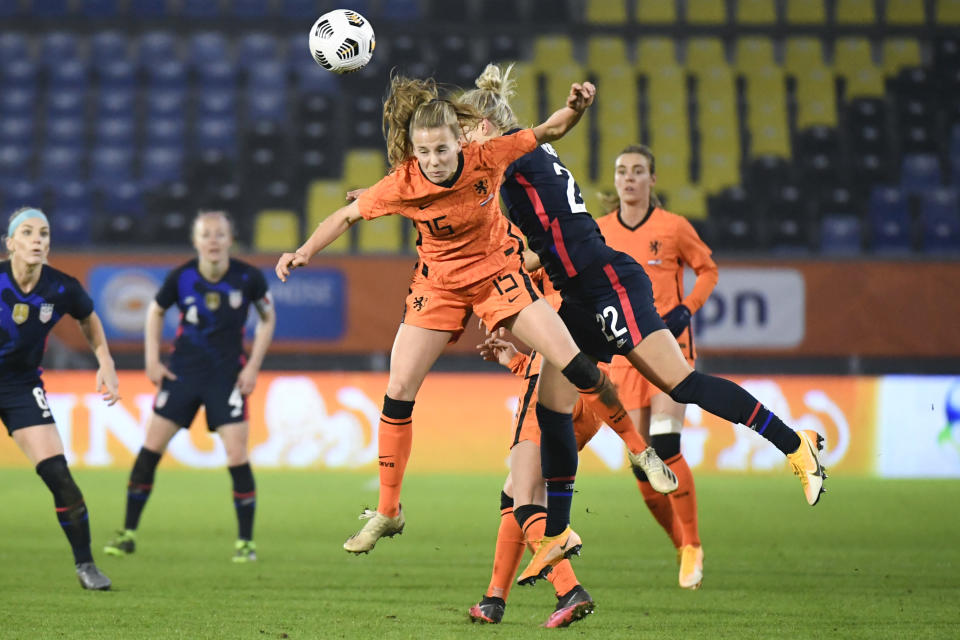 Netherlands' Lynn Wilms, and United States Kristie Mewis, rear, jump to head the ball during the international friendly women's soccer match between The Netherlands and the US at the Rat Verlegh stadium in Breda, southern Netherlands, Friday Nov. 27, 2020. (Piroschka van de Wouw/Pool via AP)