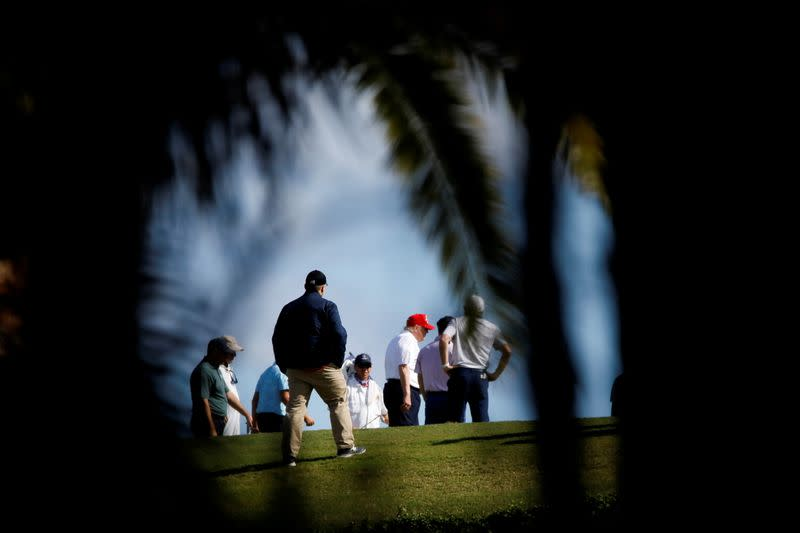 U.S. President Donald Trump plays golf at the Trump International Golf Club in West Palm Beach