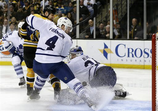 Boston Bruins right wing Nathan Horton (18) scores past Toronto Maple Leafs goalie James Reimer (34) as Maple Leafs' Cody Franson (4) defends during the second period in Game 2 of a first-round NHL hockey playoff series in Boston, Saturday, May 4, 2013. (AP Photo/Elise Amendola)