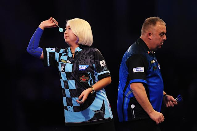 After an early 151 checkout, Suzuki missed four darts on the first set (Photo by Alex Burstow/Getty Images)