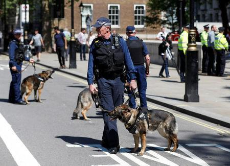 Police dogs are deployed during demonstrations outside Downing Street ahead of the visit by Turkey's President Recep Tayyip Erdogan, in London, Britain, May 15, 2018. REUTERS/Peter Nicholls