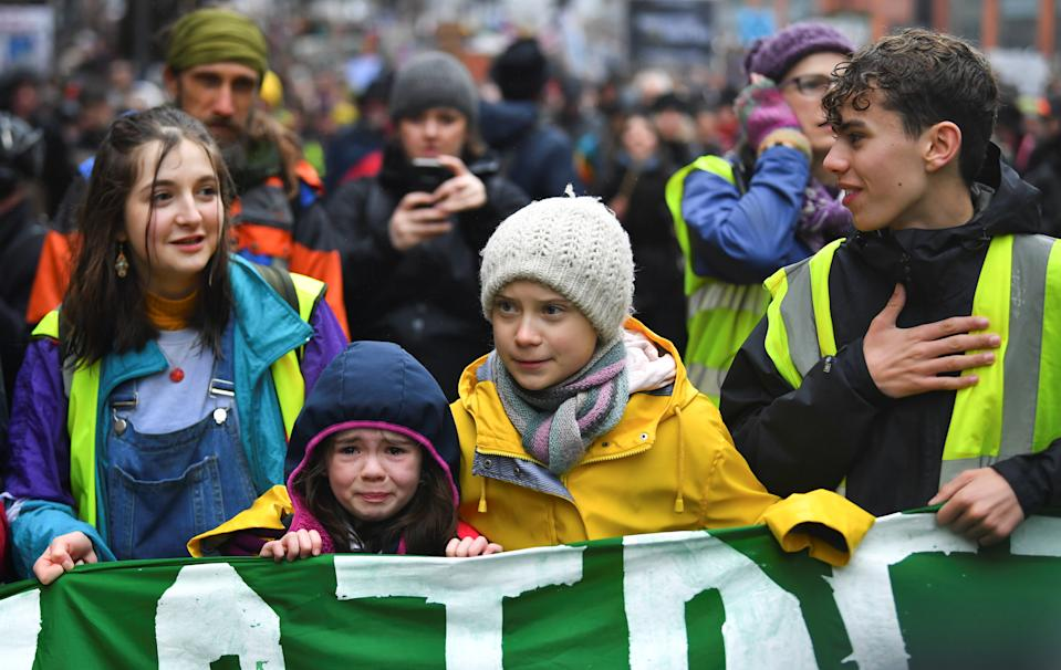 Swedish environmental activist Greta Thunberg embraces a crying girl who joined a march during a youth climate protest in Bristol, Britain, Britain February 28, 2020. REUTERS/Dylan Martinez