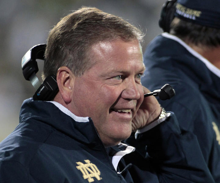"FILE - In this Sept. 15, 2012, file photo, Notre Dame coach Brian Kelly smiles on the sideline during the first quarter of an NCAA college football game against Michigan State in East Lansing, Mich. Coach Kelly called it ""white noise"" when Notre Dame jumped into the rankings after its season-opening victory over Navy. That noise is getting harder to ignore now that the Irish are 4-0, ranked No. 9 and every team on their schedule has at least one loss and none is ranked higher than No. 13. (AP Photo/Al Goldis, File)"