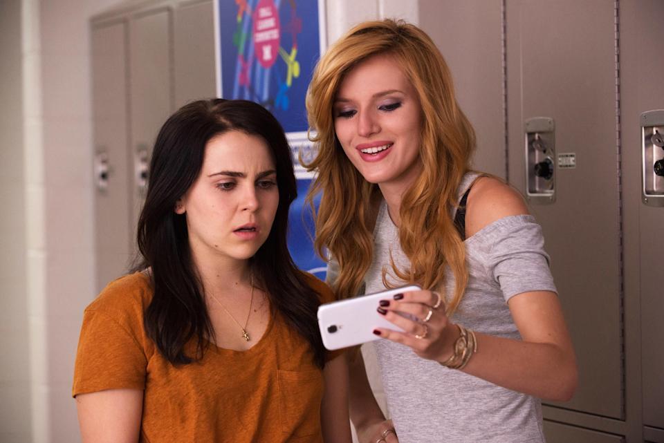 Mae Whitman and Bella Thorne looking at Bella's phone while Mae looks shocked
