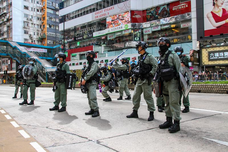 Police wait to disperse crowds during protests in Hong Kong, China on July 1, 2020. (Photo by Tommy Walker/NurPhoto via Getty Images)