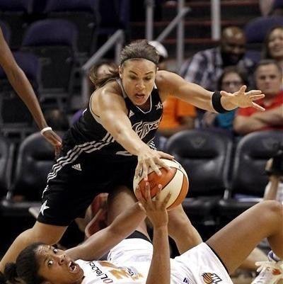 San Antonio Silver Stars' Becky Hammon, top, battles for the ball with Phoenix Mercury's Krystal Thomas in the second half of a WNBA basketball game on Saturday, Sept. 1, 2012, in Phoenix. (AP Photo/Ross D. Franklin)