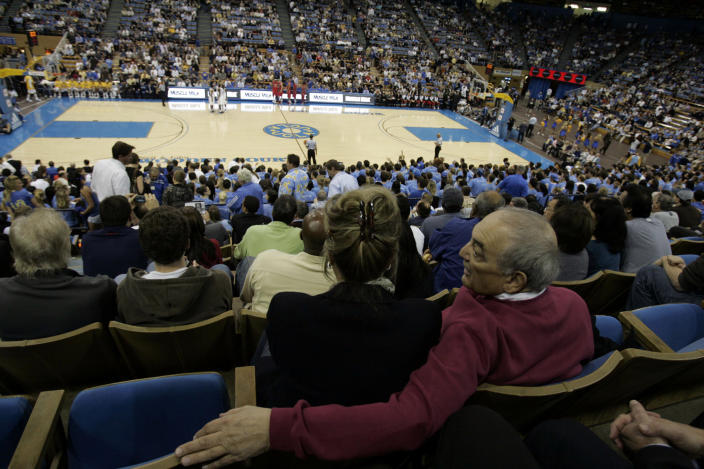JANUARY 15, 2009 – LOS ANGELES, CA: Sonny Vaccaro before the start of the UCLA–Arizona basketball game at Pauley Pavilion on January 15, 2008. He is sitting with wife Pam.  (Photo by Gary Friedman/Los Angeles Times via Getty Images)