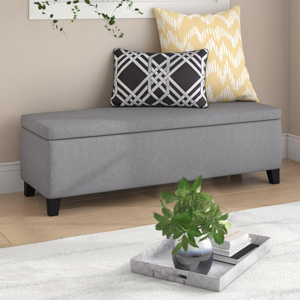 "<p>Place this <a href=""https://www.popsugar.com/buy/Schmit-Upholstered-Storage-Bench-581582?p_name=Schmit%20Upholstered%20Storage%20Bench&retailer=wayfair.com&pid=581582&price=172&evar1=casa%3Aus&evar9=46502982&evar98=https%3A%2F%2Fwww.popsugar.com%2Fphoto-gallery%2F46502982%2Fimage%2F47545981%2FSchmit-Upholstered-Storage-Bench&list1=shopping%2Cfurniture%2Corganization%2Cbedrooms%2Csmall%20space%20living%2Chome%20organization&prop13=api&pdata=1"" class=""link rapid-noclick-resp"" rel=""nofollow noopener"" target=""_blank"" data-ylk=""slk:Schmit Upholstered Storage Bench"">Schmit Upholstered Storage Bench</a> ($172) at the end of your bed.</p>"