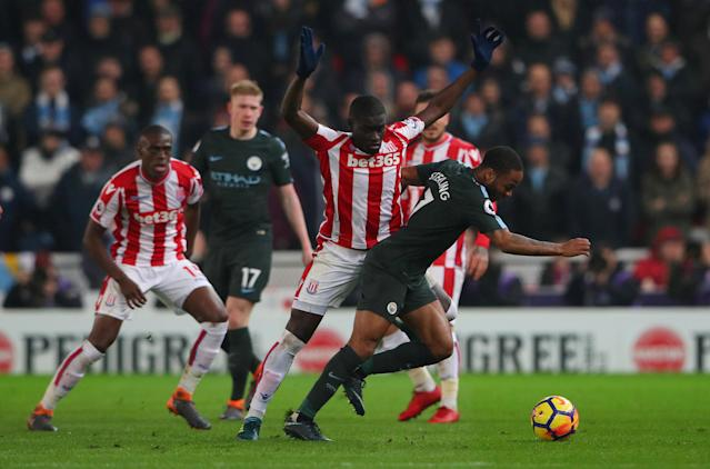 "Soccer Football - Premier League - Stoke City vs Manchester City - bet365 Stadium, Stoke-on-Trent, Britain - March 12, 2018 Stoke City's Papa Ndiaye in action with Manchester City's Raheem Sterling REUTERS/Hannah McKay EDITORIAL USE ONLY. No use with unauthorized audio, video, data, fixture lists, club/league logos or ""live"" services. Online in-match use limited to 75 images, no video emulation. No use in betting, games or single club/league/player publications. Please contact your account representative for further details."