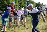 Aug 31, 2018; Norton, MA, USA; Justin Rose greets a fan during the first round of the Dell Technologies Championship golf tournament at TPC of Boston. Mandatory Credit: Mark Konezny-USA TODAY Sports