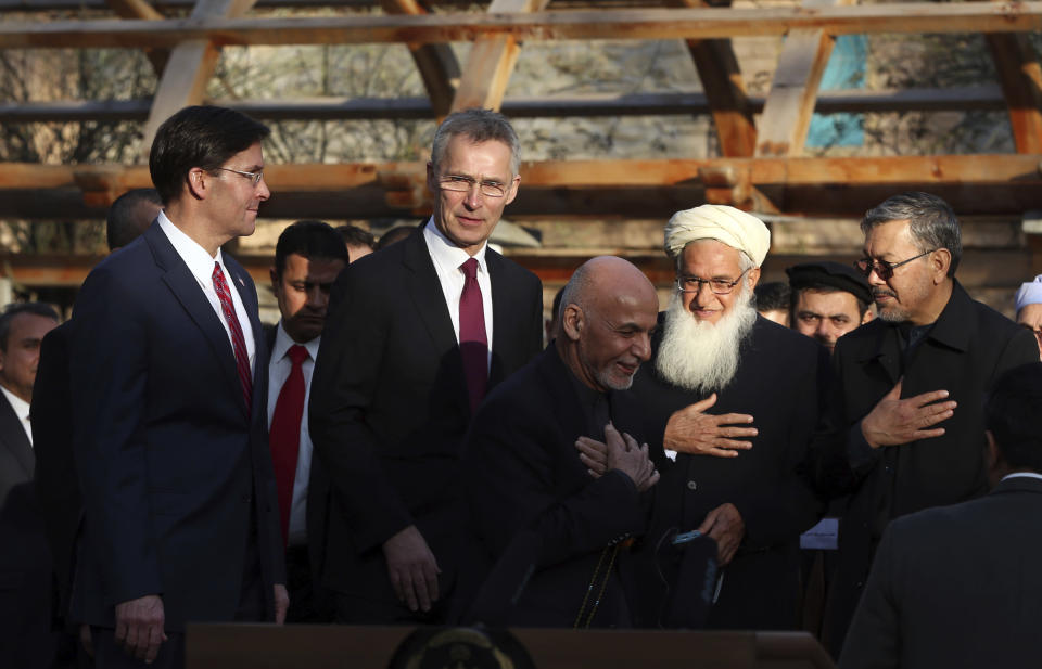 FILE- In this Feb. 29, 2020 file photo, Afghan President Ashraf Ghani, center, arrives with NATO Secretary General Jens Stoltenberg, second left, and U.S. Secretary of Defense Mark Esper, left, for a joint news conference after the US signed a peace agreement with Taliban militants, at the presidential palace in Kabul, Afghanistan. President Joe Biden is reviewing his predecessor's 2020 deal with the Taliban, which includes a May 1, 2021, deadline for a final U.S. troop withdrawal from the war-ravaged country. (AP Photo/Rahmat Gul, File)