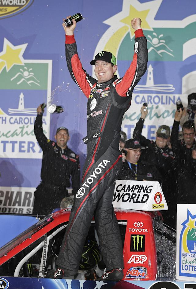 Kyle Busch celebrates in Victory Lane after winning the NASCAR Trucks series auto race at Charlotte Motor Speedway in Concord, N.C., Friday, May 16, 2014. (AP Photo/Chuck Burton)