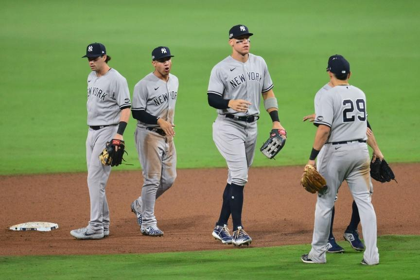 Aaron Judge high fives Yankees after win