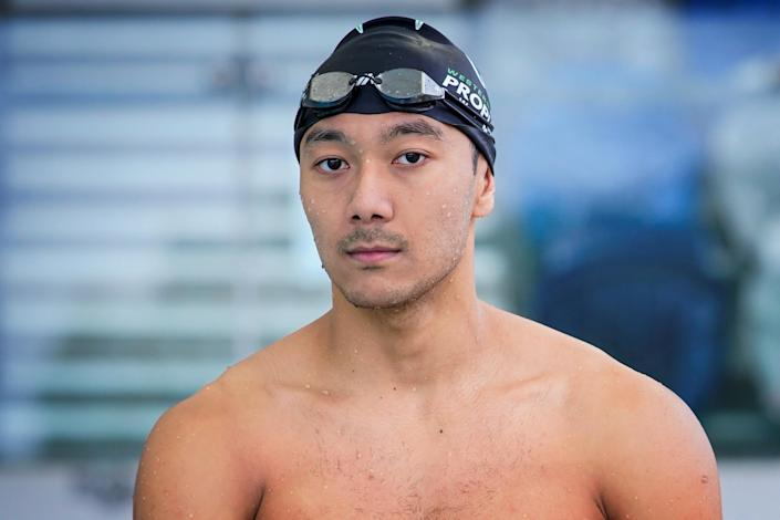 Myanmar swimmer Win Htet Oo poses for a portrait at a pool in Melbourne (Sandra Sanders / Reuters)
