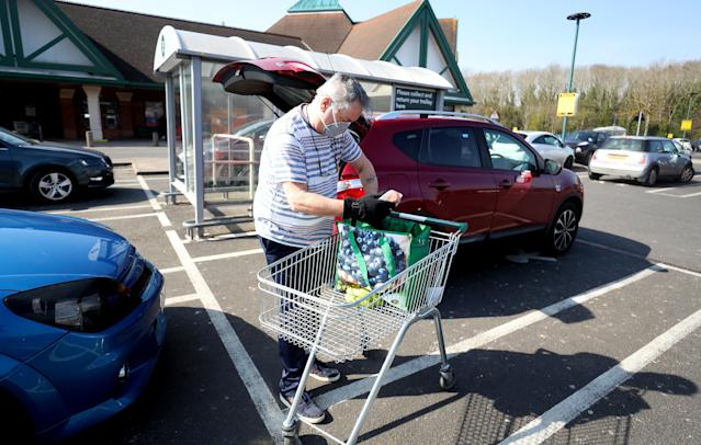 A man outside Morrisons supermarket in Malvern, Worcestershire, the day after the UK went into lockdown to help curb the spread of the coronavirus. (PA)