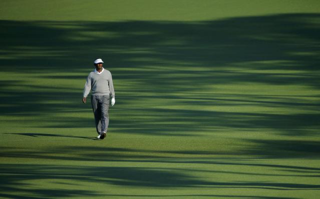 Former Masters champion Vijay Singh of Fiji walks up the second fairway during the second round of the Masters golf tournament at the Augusta National Golf Club in Augusta, Georgia April 11, 2014. REUTERS/Brian Snyder (UNITED STATES - Tags: SPORT GOLF)
