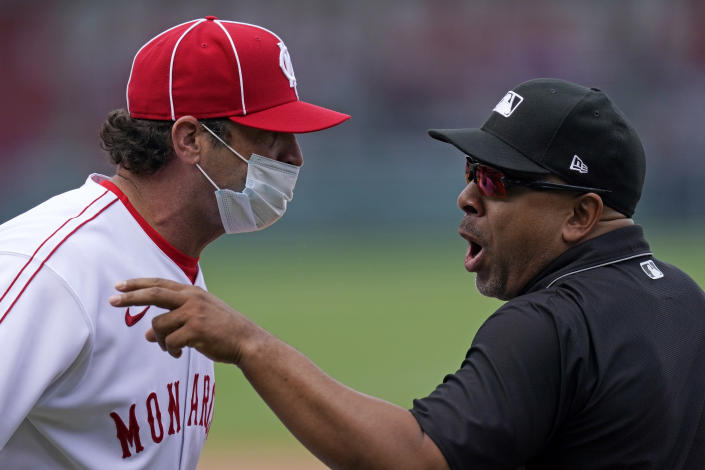 Kansas City Royals manager Mike Matheny talks with first base umpire Adrian Johnson before getting ejected during the sixth inning of a baseball game against the Detroit Tigers Sunday, May 23, 2021, in Kansas City, Mo. (AP Photo/Charlie Riedel)