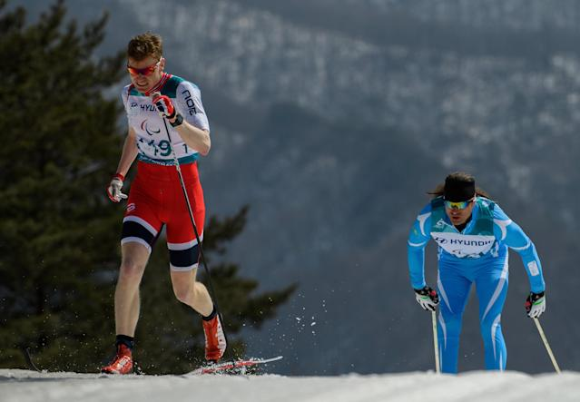 Hakon Olsrud NOR (left) and Alexandr Kolyadin KAZ race in the Cross-Country Skiing Standing Men's 1.5km Sprint Classic Semifinal at the Alpensia Biathlon Centre. The Paralympic Winter Games, PyeongChang, South Korea, Wednesday 14th March 2018. OIS/IOC/Thomas Lovelock/Handout via REUTERS