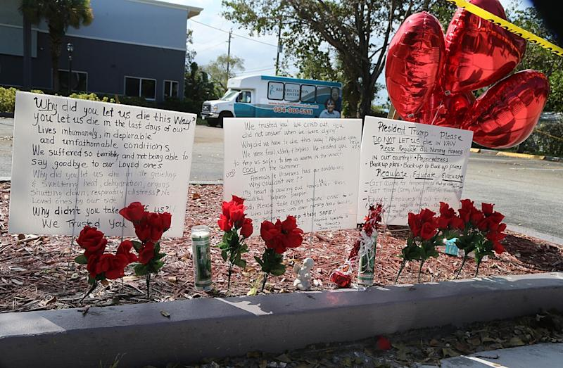 Messages have been left on the sidewalk of the Rehabilitation Center at Hollywood Hills in the days since 11 patients fell ill and eventually died. (Pedro Portal/El Nuevo Herald via Getty Images)