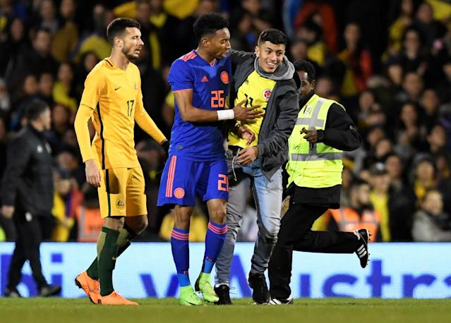 Soccer Football - International Friendly - Australia vs Colombia - Craven Cottage, London, Britain - March 27, 2018 A pitch invader hugs Colombia's Johan Mojica Action Images via Reuters/Tony O'Brien