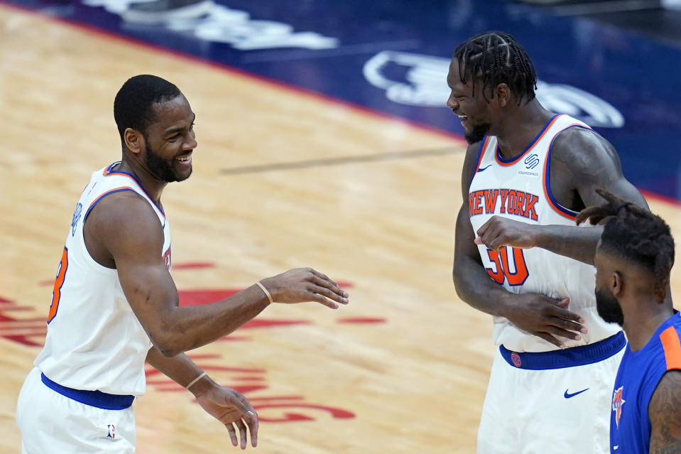 New York Knicks guard Alec Burks celebrates his 3-point basket with forward Julius Randle (30) in the second half of an NBA basketball game against the New Orleans Pelicans in New Orleans, Wednesday, April 14, 2021. The Knicks won 116-106. (AP Photo/Gerald Herbert)