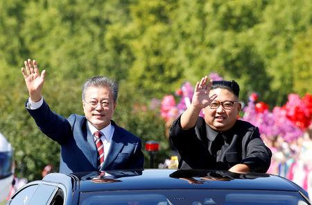 FILE PHOTO: South Korean President Moon Jae-in and North Korean leader Kim Jong Un wave during a car parade in Pyongyang, North Korea, September 18, 2018. Pyeongyang Press Corps/Pool via REUTERS/File Photo