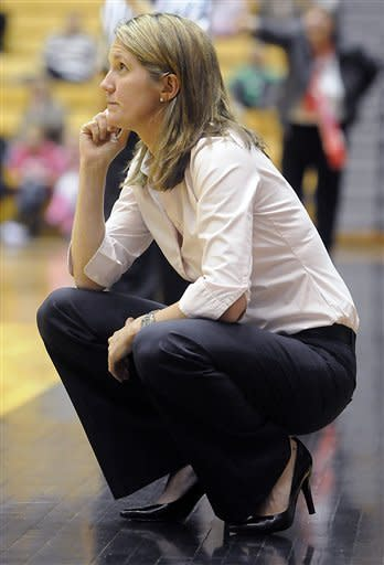 Princeton coach Courtney Banghart watches game action against Dartmouth during an NCAA college basketball game, Saturday, Feb. 25, 2012, in Princeton, N.J. Princeton won 94-57. (AP Photo/MJ Schear)