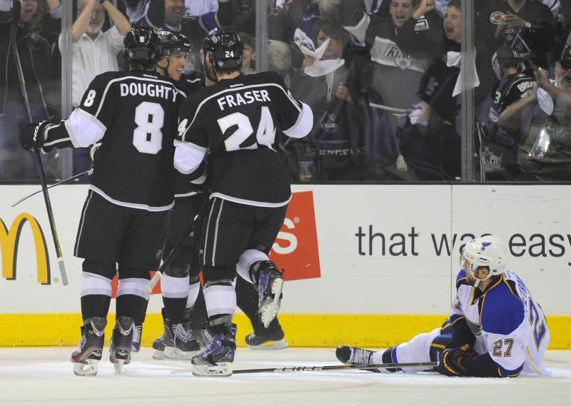 Los Angeles Kings center Jordan Nolan, second from left, celebrates his goal with Drew Doughty, left, and center Colin Fraser as St. Louis Blues defenseman Alex Pietrangelo lies on the ice during the first period in Game 4 of an NHL hockey Stanley Cup second-round playoff series, Sunday, May 6, 2012, in Los Angeles. (AP Photo/Mark J. Terrill)