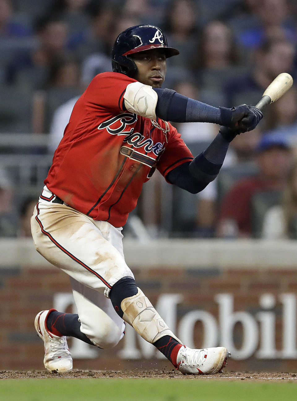 Atlanta Braves' Ozzie Albies swings for an RBI-double in the fourth inning of a baseball game against the St. Louis Cardinals, Friday, June 18, 2021, in Atlanta. (AP Photo/Ben Margot)